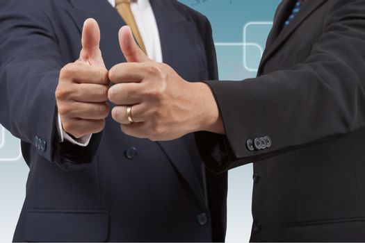 Businessmen with thumb up