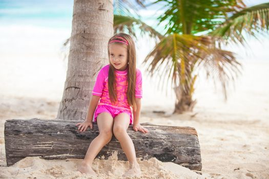 Cute little girl in nice swimsuits have fun at tropical carribean beach,Mexico