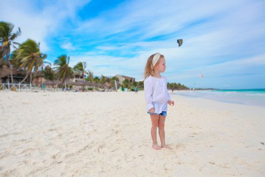 Adorable little girl on carribean white beach at sunny day