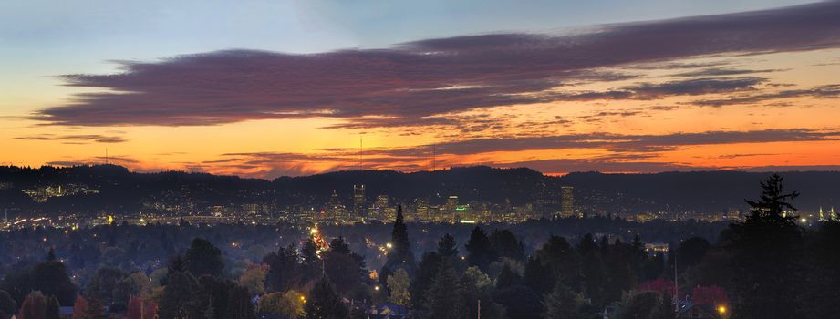 Colorful Sunset Over Portland Oregon Cityscape with City Lights and View of West Hills Panorama