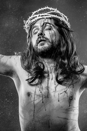Jesus Christ calvary, man bleeding, representation of passion with crown of thorns