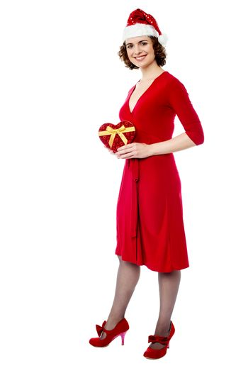 Attractive lady in red attire with xmas gift