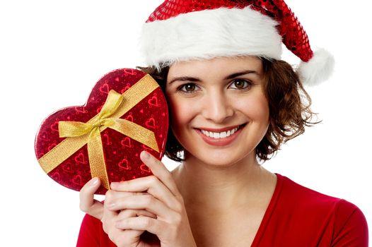 Female santa holding xmas gift