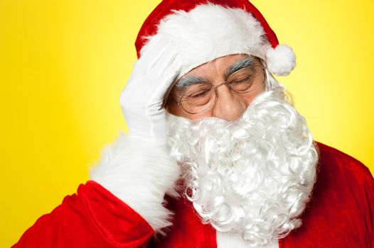 Santa having severe headache