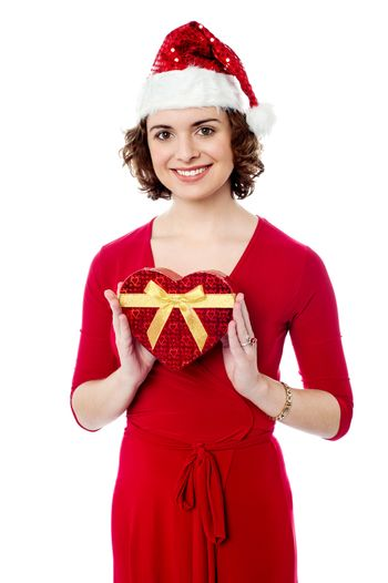 Attractive woman posing with xmas gift
