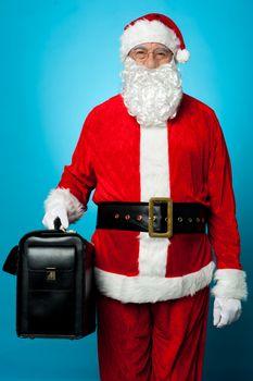 Santa holding brand new briefcase