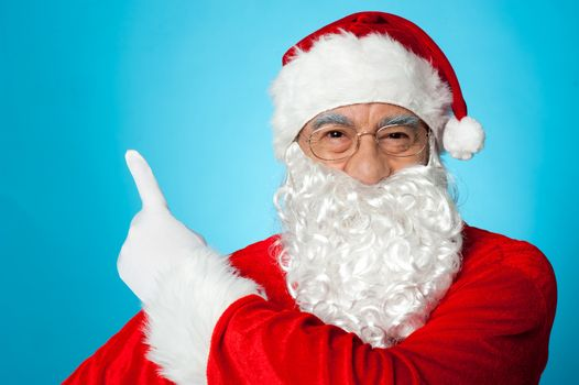 Santa claus pointing away