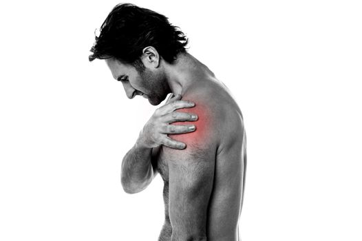 Middle aged man having shoulder ache