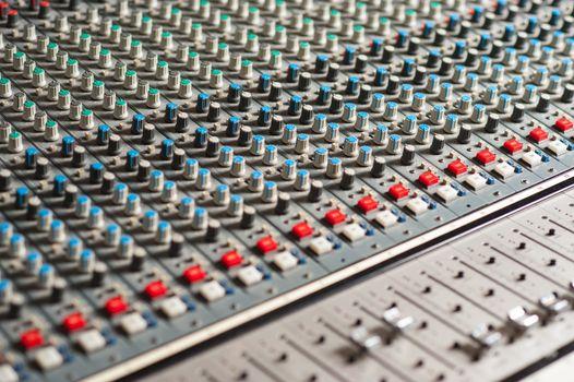 Audio mixing console, closeup shot.