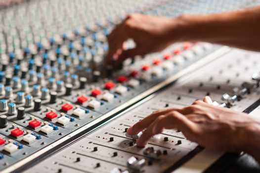 Editor adjusting the sound mixer