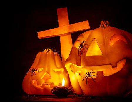 Glowing pumpkin with cross