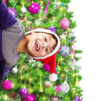 Happy boy wearing Santa hat