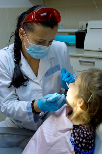 a girl at the dentist.