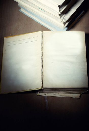 Opened old book with empy pages. Darkness added for mystic effect