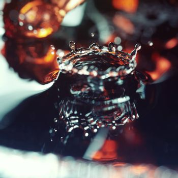 Liquid drop falling. Extremelly close-up photo with shallow depth of field