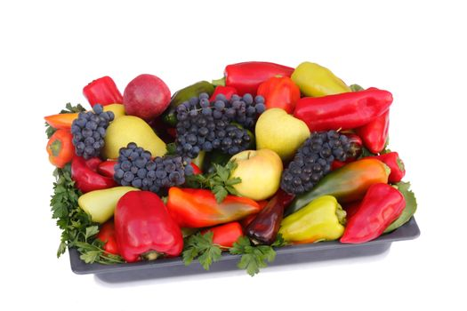 Ripe pears , apples , grapes and pepper on a platter. Presented on a white background.