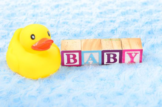 Baby blocks spelling baby and a rubber duck