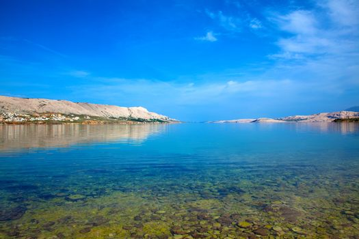 dalmatian part of the Adriatic coast and rocky beach, with blue