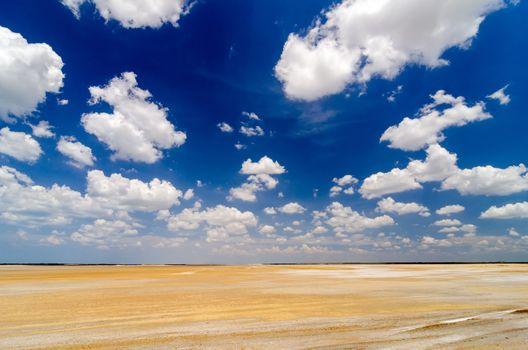 Dry desert flatlands with a dramatic blue sky in La Guajira, Colombia
