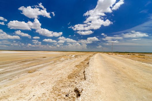 Dirt road passing through desert flatlands in La Guajira, Colombia