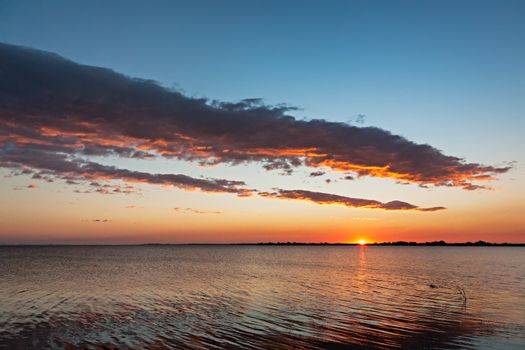 Beautiful sunset over water in Aveiro, Portugal