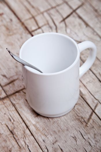 empty cup and spoon