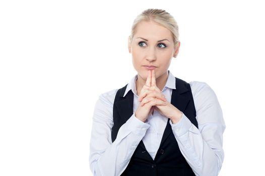 Thoughtful business woman posing