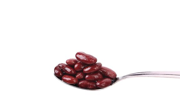 Preserve beans on a spoon.