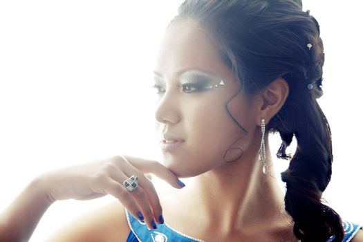 Beautiful Asian lady with luxurious accessories. Backlight added