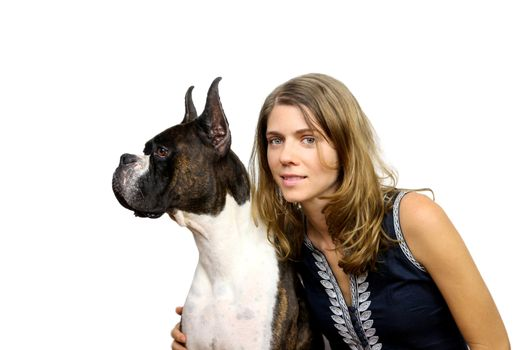 A young woman hugging  her boxer dog