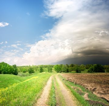Country road and storm clouds