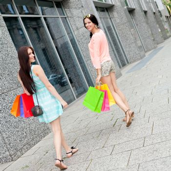 attractive young girls women on shopping tour outdoor city summer