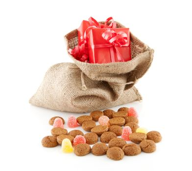 Typical Dutch celebration: Sinterklaas with surprises in jute bag and ginger nuts, ready for the kids in december. Isolated on white background