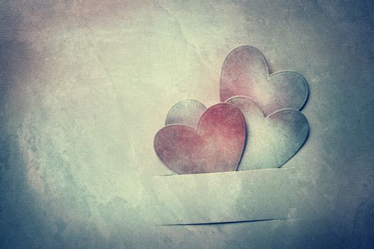 Handcrafted paper hearts in vintage tone