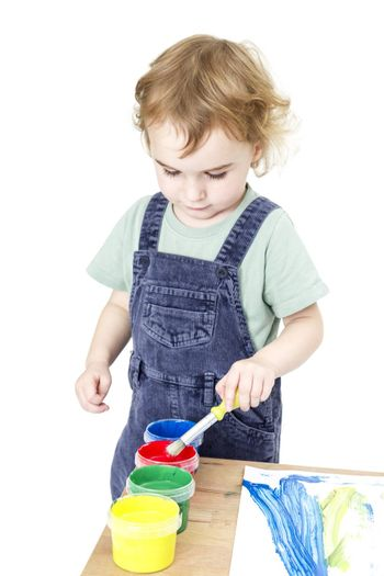 child with brush and paint isolated in white background