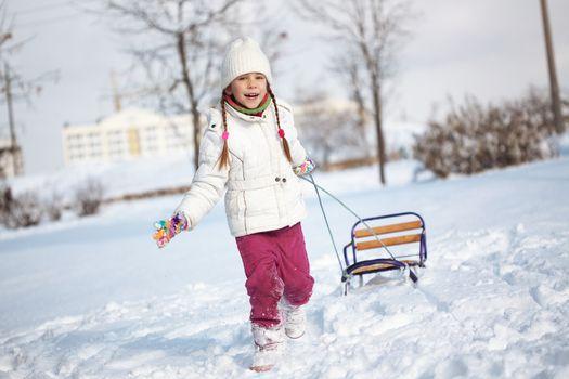 Portrait of cute little girl in winter