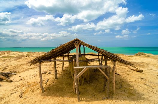 Old wooden hut next to a Caribbean beach in La Guajira, Colombia