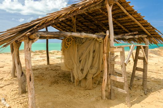 Old weathered wooden hut next to the Caribbean Sea
