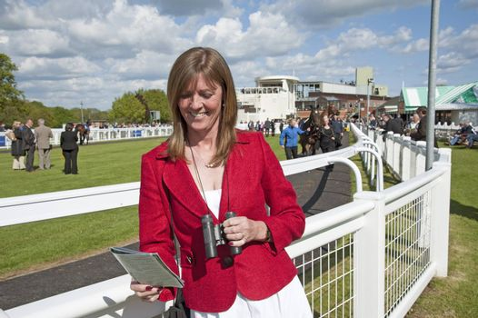 Racegoer in the parade ring of a race course