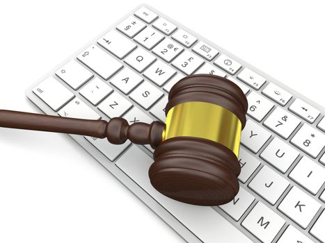 Wooden gavel on computer keyboard, symbol of law and justice in technology