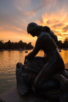 Female sculpture in Buen Retiro park lake, Madrid