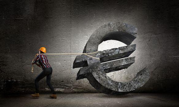 Image of woman engineer pulling euro symbol