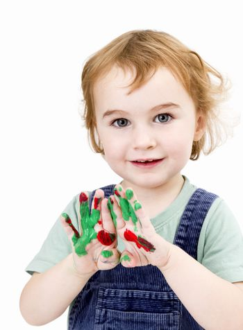 cute girl with finger paint in light grey background