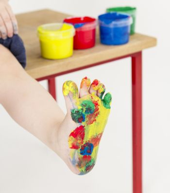 painted foot with color tubs in background