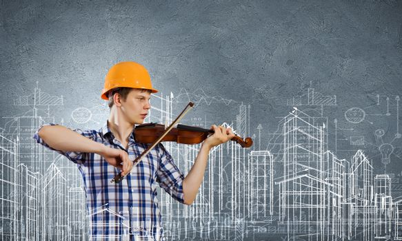 Image of man builder playing on violin