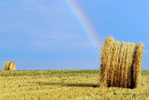 straw bales and rainbow
