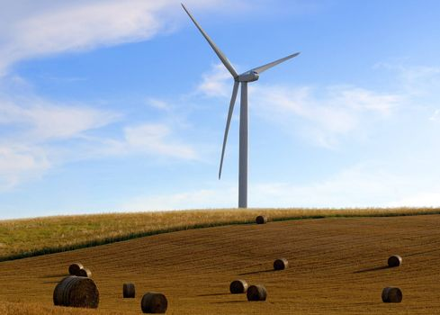 straw bales on wind turbines background
