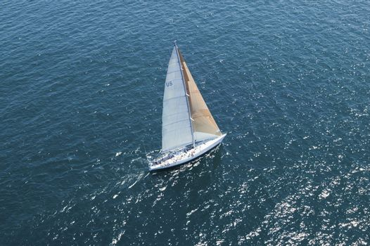 Elevated view of a sailboat at the peaceful blue ocean