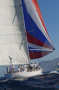 Yacht on ocean with full sail