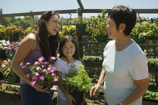 Mother daughter and grandmother shopping in plant nursery